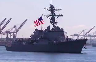 An image that appeared to be a Russian warship in Perry's military video was swapped out with this one featuring an American flag.