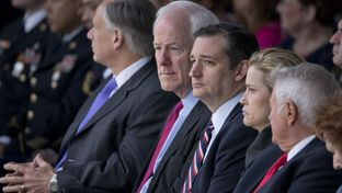U.S. Sen John Cornyn,l, sits with Sen. Ted Cruz and wife Heidi Cruz at Fort Hood Purple Heart ceremony on April 10, 2015.