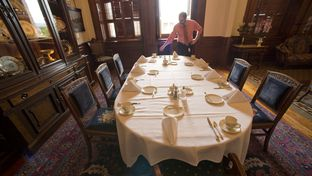 Timothy Mateer straightens napkins at the table in the Lt. Governor's Reception Room where Lt. Gov. Dan Patrick, House Speaker Joe Straus and Gov. Greg Abbott will meet April 29, 2015 for their weekly leadership breakfast.