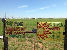 Protestors left their signs on the fence surrounding the South Texas Family Residential Center near Dilley, Texas on May 2, 2015.