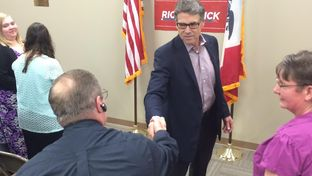 Former Gov. Rick Perry shakes hands with a man who saw him speak Saturday in Iowa. The event at the Cedar Rapids GOP headquarters kicked off a five-day swing through the state for Perry.