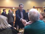Former Gov. Rick Perry greets Iowans Monday in Sioux Center. The stop at a Pizza Ranch came during a five-day swing through the Hawkeye State for Perry.