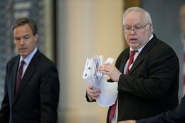 House Parliamentarian Chris Griesel is handed another stack of bills during debate on S.B. 19 Tuesday evening May 26, 2015 in the Texas House.