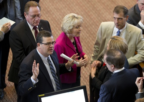 State Rep. Larry Phillips, R-Sherman, l, on the floor debating HB910 the open carry bill on the House floor May 27, 2015.