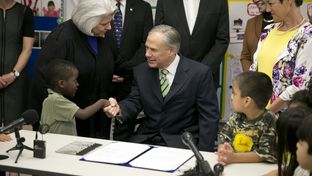 Gov. Greg Abbott at a bill signing at the Anita Uphaus Early Childhood Center in Austin on May 28, 2015.