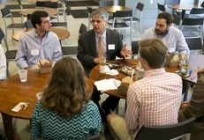 President of the University of Texas at Austin, Gregory Fenves, enjoys lunch with UT students at the student activity center on June 3, 2015