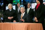 Gov. Greg Abbott signs several higher education related bills into law on June 4, 2015. He also praised state Sen. Judith Zaffirini, left, for her work in the most recent legislative session on education issues.