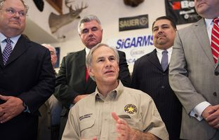 Gov. Greg Abbott in Pflugerville, Texas, for signing of open-carry bill on June 13, 2015.