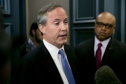 Texas Attorney General Ken Paxton speaks to media after keynoting a June 2015 event hosted by the Texas Public Policy Foundation regarding impact of the EPA's Clean Power Plan.