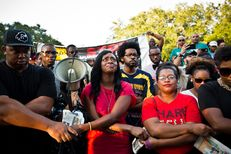 Lanitra Dean, center, and others who once were in the Prairie View A&M marching band with Sandra Bland sing at a vigil in her memory.