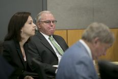 Former CPRIT executive Jerry Cobbs sits inside the 147th District Court with attorneys Jenny Brevorka and Rusty Hardin before opening arguments in his trial on Aug. 18, 2015.