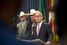 Flanked by sheriffs Brian Hawthorne of Chambers County and Andy Louderback of Jackson County, State Sen. John Whitmire, D-Houston, announces state hearings on jail standards at the Texas Capitol on Aug. 18, 2015.