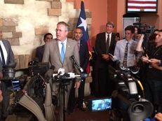 Former Florida Gov. Jeb Bush speaks with reporters Monday in McAllen. He brought his presidential campaign to the Rio Grande Valley for a fundraiser, briefing on border security with local officials and stop at a Mexican restaurant.