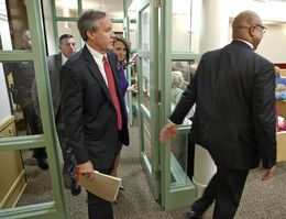 Texas Attorney General Ken Paxton arrives at court in Fort Worth to plead not guilty to felony charges.