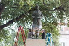 Workers prepare for the removal of the Jefferson Davis statue at the University of Texas at Austin Sunday morning.