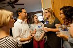 U.S. Rep. Joaquin Castro, D-San Antonio, talks to staffers from Hillary Clinton's Iowa campaign at a morning campaign event in Iowa City on Sunday, August 30, 2015.