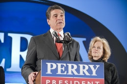 Gov. Rick Perry and his wife, Anita, addressing supporters after his fifth-place finish in the Iowa caucuses on Jan. 3, 2012.
