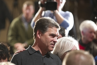 A casual candidate Rick Perry poses for photographs with Iowans December 29, 2011 in Marshalltown.
