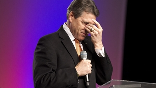 Gov. Rick Perry praying at The Response, a two-hour evangelical gathering in Greenville, S.C., on Jan. 17, 2012, resembling the massive prayer event of the same name Perry hosted in August 2011.