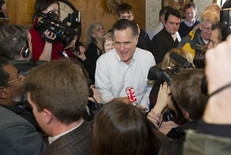 Mitt Romney surrounded by media as he makes a campaign stop at the Family Table Restaurant in Atlantic, Iowa, in January 2012.