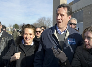 Rick Santorum and his wife, Karen, enter Valley High School in Des Moines for a speech the day of the Iowa caucuses, Jan. 3, 2012.