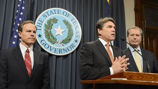 Gov. Rick Perry speaks to the media about his legislative proirities as Lt. Gov. David Dewhurst (l) and House Speaker Joe Straus (r) listen on January 9, 2013.