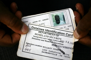 A detainee with mental health problems shows his ID card, which says he's been medically screened.