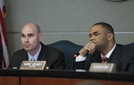 Rep. Dennis Bonnen (Angleton) (l) and Rep. Marc Veasey (Ft. Worth) listen to testimony on Voter ID bills on March 1, 2011.