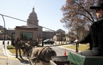 An unlikely sight descended on the Capitol on Wednesday: a contingent of donkeys circling the building in the midday sun. As Mose Buchele of KUT News reports, the animals were led there as part of a protest aimed at stopping state officials from killing wild burros in West Texas.