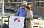 Former President George W. Bush hugs Laura Bush at the topping out ceremony for the George Bush Presidential Center at Southern Methodist University of October 3, 2011.