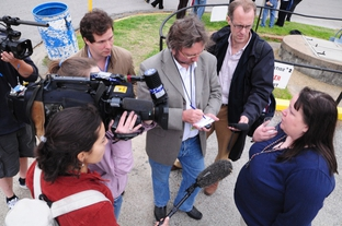 International media gather around death penalty abolitionist Kiersten Saldano shortly after the Supreme Court announced a stay of Hank Skinner's execution.