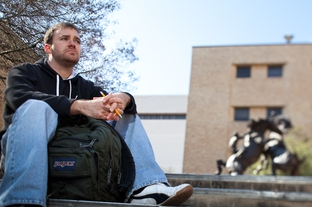 Kace Layton, 25, on the Texas State University campus in San Marcos. Layton was dropped from his grandmother's state insurance plan on his last birthday, even though federal health care reform expanded dependent coverage until age 26.