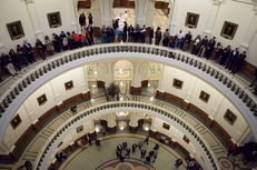 Crowds of visitors, lobbyists, and lawmakers turned out to the Texas capitol for the opening day of the 83rd legislative session, Jan. 8, 2013.