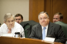State Sen. John Carona, right, and Sen. Chris Harris listen to Sen. Eddie Lucio object to a Texas Windstorm Insurance Association bill passed out of the Senate Business and Commerce Committee on June 22, 2011.