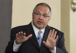 Texas Sen. John Carona, R-Dallas, uses his hands to make a point during TribLive on May 24, 2012.