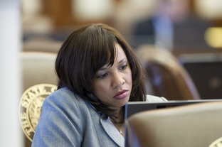 State Rep. Stefani Carter, R-Dallas, at her desk on the House floor on May 16, 2011.