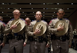 Three of 44 Department of Public Safety troopers graduating from cadet training pause for prayer on April 7, 2011