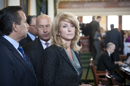 State Sen. Wendy Davis, D-Fort Worth, leaving the Senate chamber with colleagues Sen. Carlos Uresti, D-San Antonio, and Sen. John Whitmire, D-Houston, after a press conference on May 30, 2011.