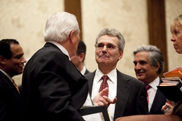 Harvard biologist Dr. Ronald DePinho (r) is greeted by Board of Regents chairman Gene Powell (l) after being named the head of M.D. Anderson Cancer Center in Houston on May 11, 2011.