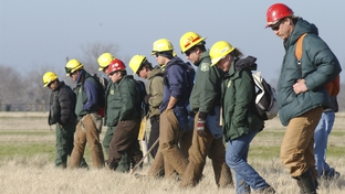 Members of the Los Padres and INYO C-25 firefighting teams from Oregon and California walk shoulder-to-shoulder through fields outside this north Texas town as the search for Columbia space shuttle debris  Photo