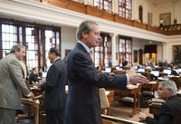 Lt. Gov. David Dewhurst reaches to shake the hand of a member following his visit to the House chamber Thursday afternoon to discuss budget matters on May 19, 2011.
