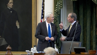 State Sen. Steve Ogden (l), R-Bryan, talks with Lt. Gov. David Dewhurst (r) during debate on SB1581 a fiscal matters bill in the Texas Senate chamber on May 20, 2011.