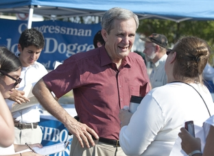 Democratic U.S. Congressman Lloyd Doggett smiles while talking with an Austinite at a community event on August 27, 2011.