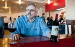 Gary McKibben, owner of the Red Caboose Winery in Clifton, uses paintings by local artists like Robert Fobear to distinguish his wine labels.