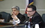 Rep. Roland Gutierrez (r)(D-San Antonio) questions a witness as a House committee takes testimony on Voter ID bills on March 1, 2011.