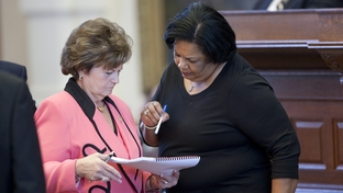 State Rep. Linda Harper-Brown (l), R-Irving, discusses TXDOT sunset legislation with State Rep. Yvonne Davis, D-Dallas, at the Texas House on April 29, 2011.