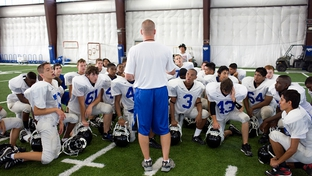 Students at North Forney High School work through football practice on the first day of school in Forney, Texas, in August 2010.