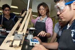Students in the Hidalgo Independent School District physics classroom work on a project on acceleration with a sloped ramp in a regular science class at Hidalgo Early College High School.