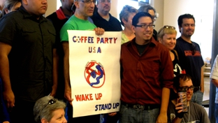 Members of the San Antonio chapter of Coffee Party USA pose with a sign.