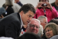 Gov. Rick Perry talks with Greene County Republicans in Jefferson, Iowa, on Sept. 15, 2011.